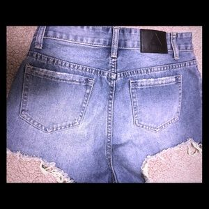 Zip em'  up distressed cut off! Women's size 29